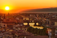 Florence, Arno River and Ponte Vecchio at sunset, Italy (romancandletours) Tags: old city travel bridge sunset red summer sky urban italy panorama orange sun mountains reflection building art tourism monument water beautiful skyline landscape golden florence europe european cityscape view vibrant horizon scenic landmark medieval historic tuscany firenze metropolis arno cloudless inspirational toscana viewpoint picturesque middleages renaissance hdr magnificent pontevecchio reflextion florenz monumental vecchio toskana arnoriver impressing largetown majortown
