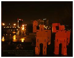 Small bots, big city (sweetmeika) Tags: cubebot cubebots reflection nighttime nightshot toys woodentoy robot robots city urban