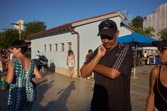 hide and seek (Carey Moulton) Tags: croatia street decisive moment people urban life