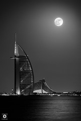 ~ The Super Moon over Super Burj Al Arab ~ (Chirag Khatri) Tags: nikon nikontop nikonworld dslrofficial dslr monochrome moon supermoon 14112016 141116 night cityscape sea ocean water building mydubai burjalarab uae balck white blackandwhite sky light calm super dark creative astro seascape jumeirah palm palmjumeirah dubai