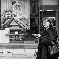 Manchester 045 (Peter.Bartlett) Tags: manchester bag noiretblanc shopfront olympusomdem5 postergirl square reflection window city urbanarte woman walking urban unitedkingdom shopwindow lunaphoto streetphotography girl sign monochrome uk m43 microfourthirds poster bw eyecontact macphuntonality blackandwhite peterbartlett candid england gb