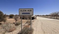 Namibia's Beauty:  46.  Klein Aub bridge (ronmcbride66) Tags: namibia namibiasbeauty drought riverbed dryriverbed desert kleinaub kleinaubriver bridge roadsign