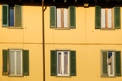 I swear I see a face in every window (Luca Quadrio) Tags: view curtain building window wooden abstract home colours sunset background architectural estate panel exterior yellow residence classic construction sunlight sun house residential architecture green wall frame apartment design pavia lombardia italia it