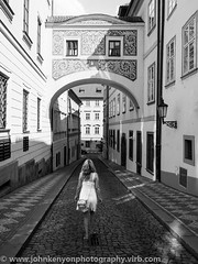 Girl in symmetry (johnkenyonphotography@gmail.com) Tags: street city roof portrait people blackandwhite bw music white holiday streetart black streets colour tower art history blanco church monochrome beauty landscape photography freedom artist noir break republic peace grafitti view shot y czech prague spires candid negro protest churches free lisa chapel praha bn spire roofs communism chapels czechrepublic beatles cz monochrom domes johnlennon et blanc praag thebeatles • peacewall hcb citybreak straatfotografie straatfotograaf