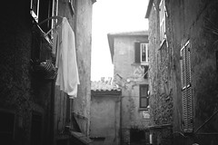 You left me hung out to dry (Playing_with_light) Tags: houses light sky bw italy out nikon village dry cloths anguillara hung d800