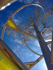 Ever-Bloomer (ggppix) Tags: sky sculpture art public floral yellow wisconsin hospital spiral stainlesssteel outdoor plastic madison universityofwisconsin sculptor danecounty theamericancenter uwhealth appleiphone5 garyglenprice