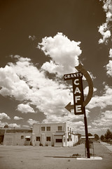 Route 66 - Grants Cafe (Frank Footer Fotos) Tags: road new trip travel vacation sky usa white black southwest west art classic home beer sunshine sign shop wall sepia architecture bar clouds america vintage buildings point mexico photography freedom restaurant town office store cafe neon framed parking small fine mother lot murals sunny diner bistro 66 retro adventure business route sidewalk posters buy prints americana kicks motor arrow roadside nm decor rt grants attractions refreshments