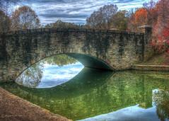 Freedom Park Bridge (David Warlick) Tags: bridge autumn lake fall water nikon unitedstates charlotte northcarolina autumncolors charlottenc freedompark photomatixpro adobelightroom pixelmator