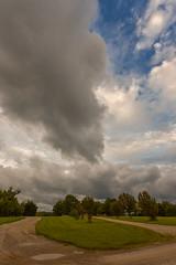 Drooping Cloud (thefisch1) Tags: humidity cloud unusual shape type kansas moisture air topeka road country driveway sky oogle vertical slant gravel nikon nikkor