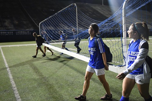 With her new American teammates, Tomoko Matsumoto, an exchange student from Japan, carried a soccer goal back to the storage area, San Jose State University, Calif.