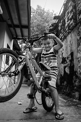 Little boy with bycycle (B&W version) (-clicking-) Tags: streetphotography streetlife children child childhood childish childlike boy bicycle life dailylife saigon vietnam blackandwhite blackwhite nocolors monochrome monotone bw