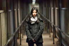 Dark depths and bokeh (Kevin Casey Fleming) Tags: dark lighting depth depthoffield dof d90 tunnel story poem leadinglines lines field black her girl woman beautiful bokeh coat standing centered eyes chicago portrait face thoughts depths soul journey white color matching surreal fine art