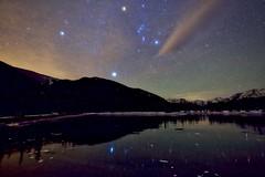Orion and Sirius Kananaskis Alberta (John Andersen (JPAndersen images)) Tags: aurora clouds forest forgetmenotpond kananaskis mysterious night orion sirius stars