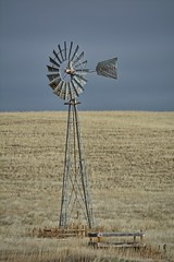Bracing For The Storm (RootsRunDeep) Tags: windmill windmillwednesday prairie grass wyoming storm sky clouds landscape ranch rural country aerometer