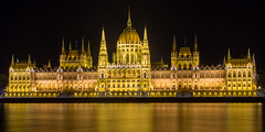 Night Time view of the Hungarian Parliament Building and the Chain Bridge over the Danube River, Budapest, Hungary, Europe