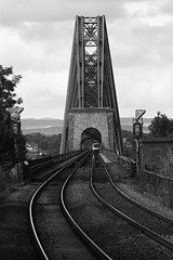 Forth Rail1 BW (Little Boffin (PeterEdin)) Tags: railroad travel bridge blackandwhite bw white black slr monochrome station metal canon eos rebel grey scotland blackwhite iron track alba steel platform tracks bridges rail railway trains railwaystation trainstation dslr canoneos railwaytrack singlelensreflex blackandwhitephotography forthrailbridge ecosse railroadstation blackwhitephotography railroadtrack firstscotrail dalmeny networkrail railroadbridges railwaybridges 400d cantileverbridges rebelxti canoneos400d canonrebelxti canon400d digitalsinglelensreflex dalmenystation dunmheinidh