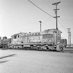 [Texas and New Orleans, Southern Pacific, Diesel Electric Road Switcher No. 182] (SMU Central University Libraries) Tags: blw trains sp tno railroads espee railroademployees switchers diesellocomotives railroadyards baldwinlocomotiveworks