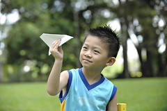Perfect Paper Planes (Centennial Parklands) Tags: boy cute nature beauty grass childhood smiling closeup garden children asian fun toy creativity outdoors happy flying child candid small joy chinese happiness son aeroplane fantasy imagination cheerful carefree enjoyment offspring purity aspirations facialexpression paperplane