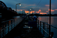 The illuminated jetty (sanat_das) Tags: d800 50mm river hoogly water clouds jetty lights lateafternoon