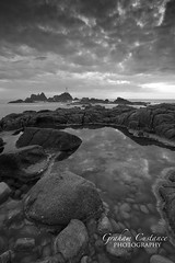 Corbiere Lighthouse, Jersey (gracust) Tags: corbierelighthouse lighthouse jersey channelislands blackandwhite mono seascape rockpools rocks landscape corbiere