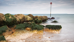 Across the water (stewartl2010) Tags: hengitsburyhead landscape cloudy colorefexpro4 rocks longexposure seaweed nikfilters daylight dorset coastal groynemarker bigstopper seascape groyne isleofwight christchurchharbour uk bournemouth england unitedkingdom gb