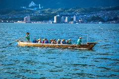 Kasa  wearing people on Hiroshima Bay (mookiebomber) Tags: japan hiroshima kasa itsukushima asia bay boat nippon sea ocean waves