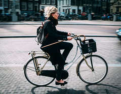 Riding Cane (Rolling Spoke) Tags: bike bicycle bicicleta bici bicicletta fiets ciclismo velo ride cycle cycling cane carry hold street streetphotography road path girl lady pan motion singel amsterdam