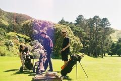 Golf Boys (Denzel De Ruysscher) Tags: 35mm pentax colour film explore green golf course sky sun nature