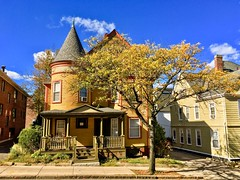 House with a turret ((Jessica)) Tags: turret newengland autumn house fall somerville tree architecture massachusetts bluesky yellowhouse paintedlady
