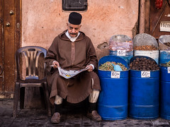 Moroccan faces (Georgie Pauwels) Tags: street travel morocco streetphotography olympus seller reading spices seasonings candid