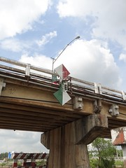 Under the bridge (program monkey) Tags: vietnam mekong river delta cargo boat ben tre tra vinh bridge navigation sign symbol