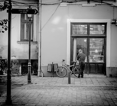 (DoruDV) Tags: bw blackwhite professional nikond3200 nikonphotography nikon nikkor1855mm nightfall man shopping bike street shop romania bistrita casaculei