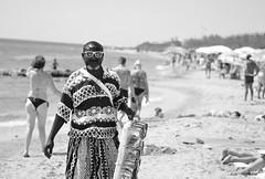 Vu' cumpr ( Ivan) Tags: vucumpr vu cumpr african seller beach sea seaside marina di pescoluse maldive del salento lecce puglia apulia italy summer portrait black white street