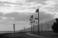 North Kihei Beach 2 (Unbeknownst808) Tags: ocean park family mountain beach sign coast solar maui poles paths lamps kihei trainquil