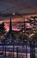 Gothic Sunset (Tremayne Price Photography) Tags: street trees sunset orange chicago church clouds fence lights iron purple steeple madison crucifix bishop hdr wrought