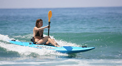 Girl-Kayaking-Surfing-on-3-4-Malibu-Kayaks
