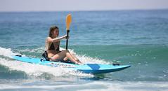Girl-Kayaking-Surfing-on-3-4-Malibu-Kayaks