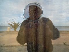 self portrait (maximorgana) Tags: shadow sea selfportrait reflection tree beach broken glass o horizon palm reflected lamangadelmarmenor gunshot losnietos