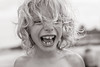 The beach (Dalla*) Tags: boy portrait beach nature smile outside kid spain sand child joy happiness curls curly laughter wwwdallais
