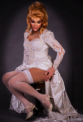 Sensual bride (Juliapanther Over 23 million views, thanks!!!) Tags: pink portrait people white bride necklace costume high model glamour long pumps dress julia silk makeup posing lips blond blonde heels makeover lipstick gown bridal satin panther pantyhose pinup nylon suspender juliapanther