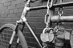 CPR (Georgie_grrl) Tags: blackandwhite toronto ontario bike bicycle lock sunny chain explore pentaxk1000 kensingtonmarket cpr whome bikingtoronto biglock ilford400bw rikenon12828mm changeyourliferideabike october2015