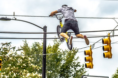 bmx extreme team making stunt in downtown york south carolina at summerfest 2015 (DigiDreamGrafix.com) Tags: show above park county street york city trees boy sky usa men fall sc boys up bike bicycle wheel sport festival person town big team jump bmx freestyle downtown cyclist air awesome extreme helmet young southcarolina bikes guys dirt cycle skate trick summerfest rider stunt activities whiterose 2015 whels treelinne