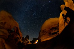 Stars, rocks, arches and men (Mstraite) Tags: light shadow sky lightpainting cold art silhouette rock night canon painting stars star nationalpark arch photographer artistic joshua tripod joshuatree tokina national 29palms deltaco whitetank milkyway
