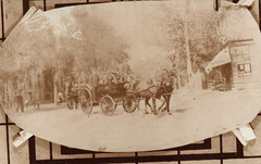 Fire Wagon Being Pulled by Horses Through Street