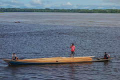 Don't Rock the Boat (Chris Huddleston) Tags: jungle blue floating river napo water balance boat wood mix lumber red