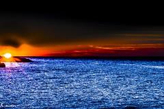 Lake Erie Sunburst and the Icarus Agenda (kaustavmukherjee) Tags: erie lake nature loneliness birds colors blue serene quiet picture fall sigma 85 pentax k50 8514 incredible orange icarus man sun sunburst sunrise