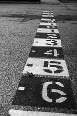 329/366: Thankful (dharder9475) Tags: 2016 329366 365project abstract asphalt bw blackandwhite leadingline lowangle metaphor negative numbers painted pavement playground positive privpublic school