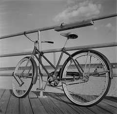 Beach Cruiser (Dalliance with Light (Andy Farmer)) Tags: bicycle rolleiflex water diafine scans film shore jersey mediumformat hp5 ocean boardwalk asburypark nj bw iso800 beach newjersey unitedstates us
