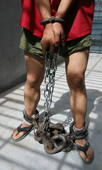 After violated rules prisoner punished with chain hanged, a second pair of heavy shackles is bolted as long term punishment (asiancuffs) Tags: handcuffs handcuffed shackles shackled inmate prisoner arrest arrested