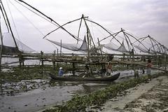 Chinese fishing nets (Steve.frog) Tags: india cochin backwaters mahabalipuram agra tajmahal asien asia indien kerala woman boat fisher fishernet scan negative film minox filmscan 35gt